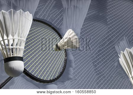 Abstract arrangement of shuttlecock and racket closeup