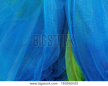 Contrasting blue and green children's fishing nets