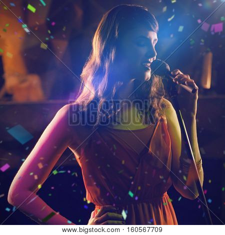 Woman singing in bar against flying colours