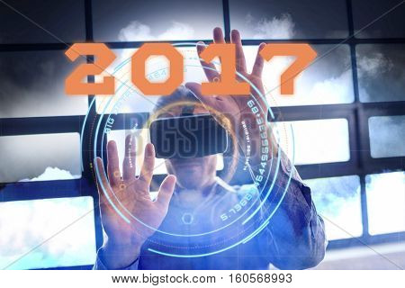 Digital image of new year 2017 against cloudy sky