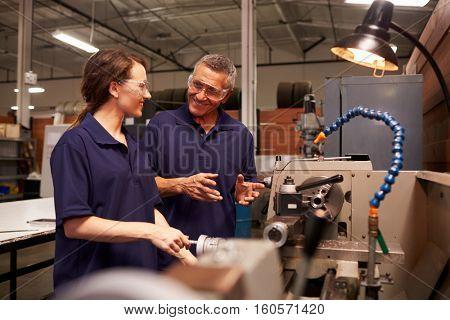 Engineer Training Female Apprentice On Milling Machine