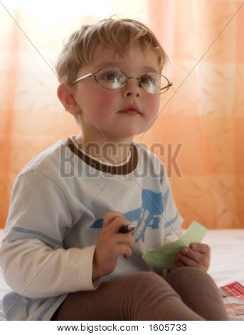 The Boy In Glasses