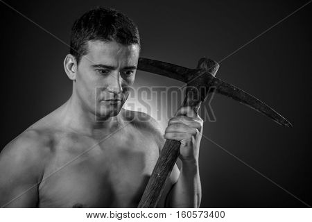 Construction worker portrait holding a peak.