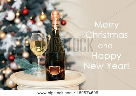 Happy New Year Card with white wine or champagne in Christmas setting. Winter holidays theme