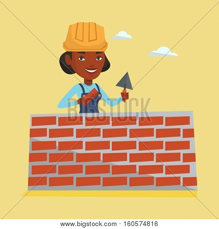 Young bricklayer in uniform and hard hat. African-american bicklayer working with spatula and brick on construction site. Bricklayer building brick wall. Vector flat design illustration. Square layout