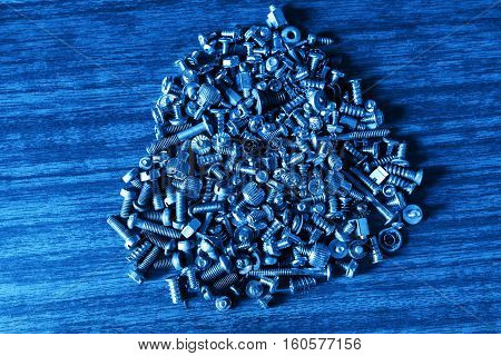 Male screws and female screws on workshop desk tools background hd