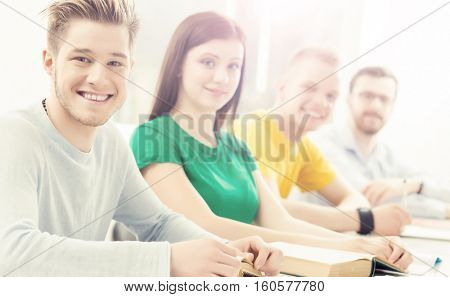 Young and smart students learning in a classroom