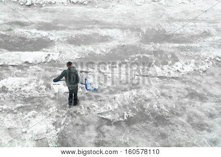 Man shoveling snow. Minimalistic image. Top view