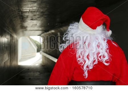 Portrait of a Christmas Santa Claus in a Tunnel.