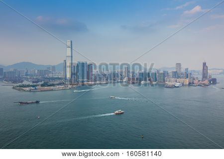 Skyscrapers on sea shore in business area, sailing ships in Hong Kong, China, view from China Merchants Tower