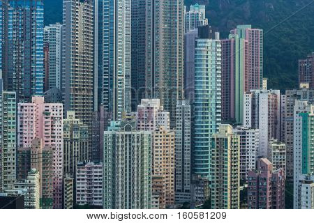 Residential buildings in sleeping area near mountain in Hong Kong, China, view from China Merchants Tower