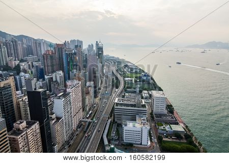 Tall buildings, modern highway on sea shore in Hong Kong, China, view from China Merchants Tower