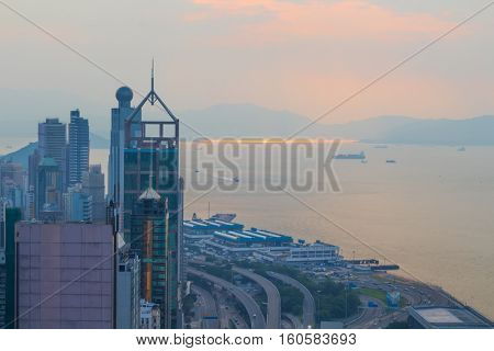 Skyscrapers, highway on sea shore in business area at morning in Hong Kong, China, view from China Merchants Tower
