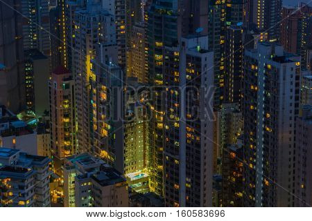 Skyscrapers and modern tall residential buildings in Hong Kong, China at night, view from Queen Garden