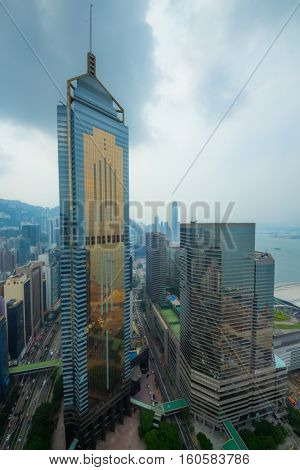 Glass Central Plaza, sea shore in Hong Kong city, China at cloudy day, view from China Resources Building