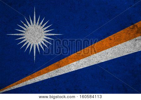 The Marshall Islands Flag On An Old Grunge Background