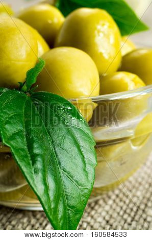 Green Marinated Olives Pitted In A Glass Cup
