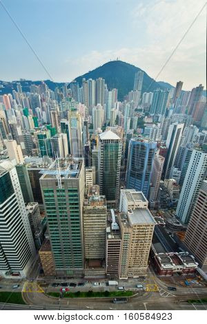 Skyscrapers and tall buildings in business area and mountain far away in Hong Kong, China, view from China Merchants Tower