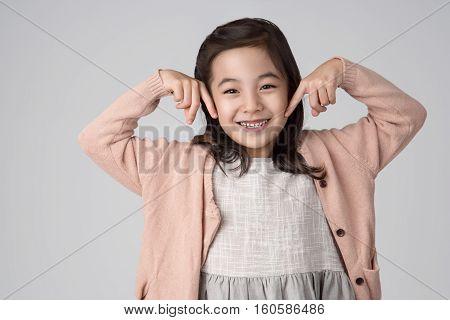 East asian girl studio portrait - isolation shot