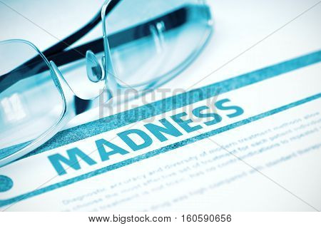 Madness - Printed Diagnosis on Blue Background and Glasses Lying on It. Medicine Concept. Blurred Image. 3D Rendering.