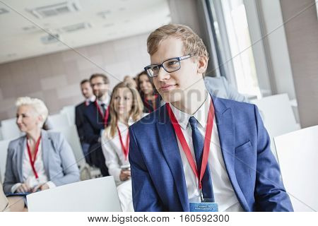 Businessman attending seminar in convention center