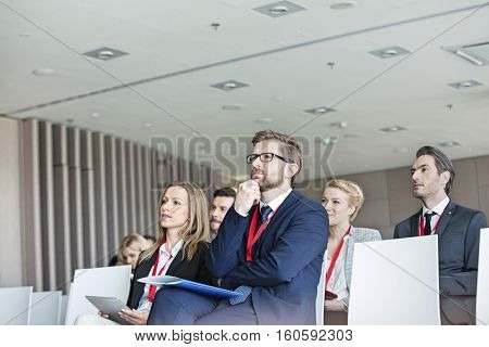 Business people attending seminar in convention center
