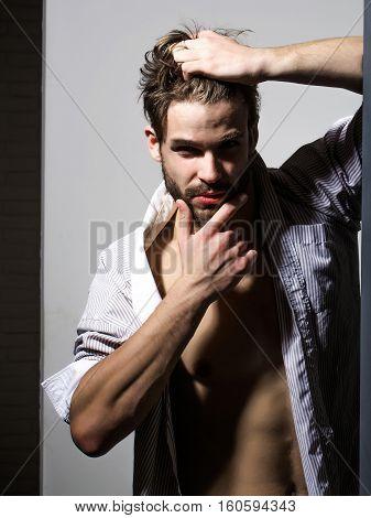 Man Touches Hair And Beard