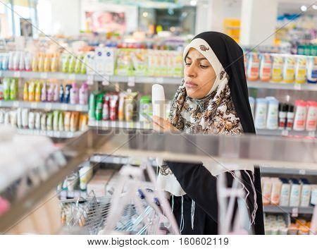 Hijab Arab Muslim lady doing shopping in big modern city mall