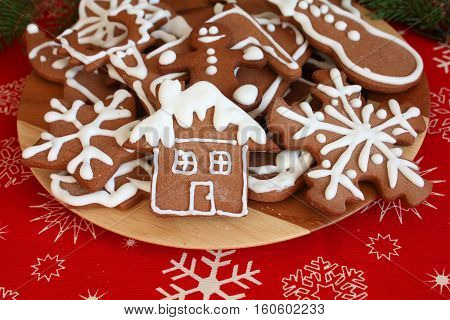 Plate of Christmas gingerbread cookies on table