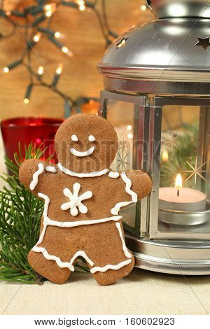 Gingerbread man and lantern. Christmas decoration background