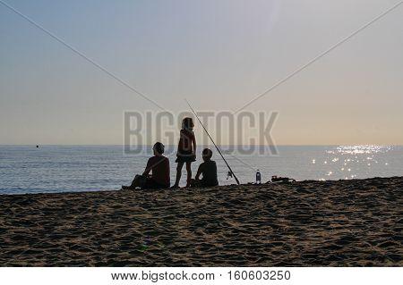 Photo of fishermen fishing on a sea bank.