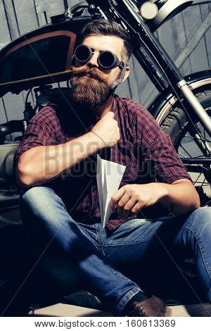 Biker Man With Paper Plane