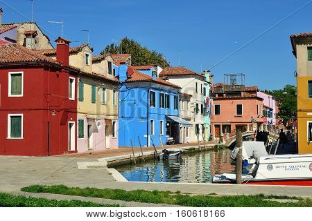 BURANO - SEP 23 2014: Colorful facades on the famous Burano island Venice. Landmark of Veneto region Italy