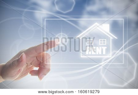 Finger pressing touch screen interface with house real estate rental sign