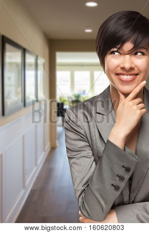 Attractive Curious Mixed Race Woman Inside Hallway of New House.