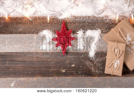 Christmas decoration and gifts. Happy New Year 2017 greetings on wooden instead of zero star.