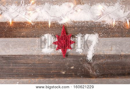 Happy New Year 2017 greetings on wooden instead of zero star. Christmas decoration