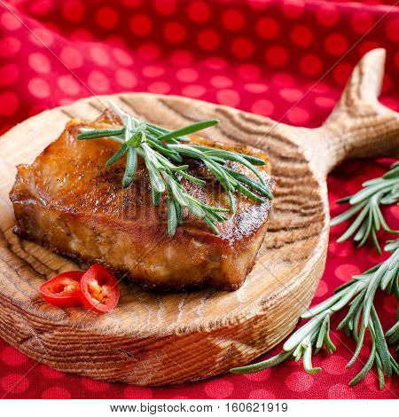 Grilled Meat With Rosemary On A Kitchen Board