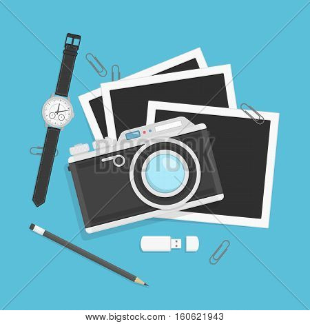 Camera with photos in flat style isolated on blue background. Vintage Photo camera with picture, wrist watch, pencil, paper clips and USB flash drive.