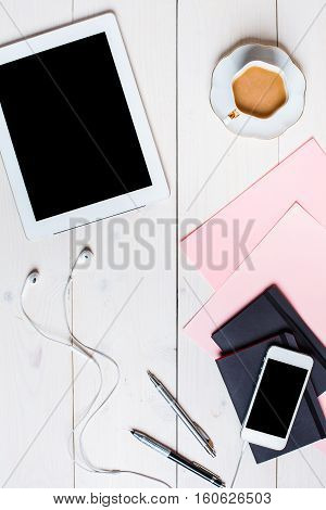 Flat lay, top view, mock up women's accessories on a white background. phone, pen, paper, a cup of coffee, notebook