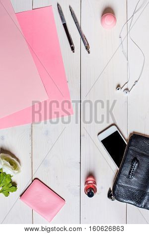 Flat lay, top view, mock up women's accessories on a white background. phone, pen, paper