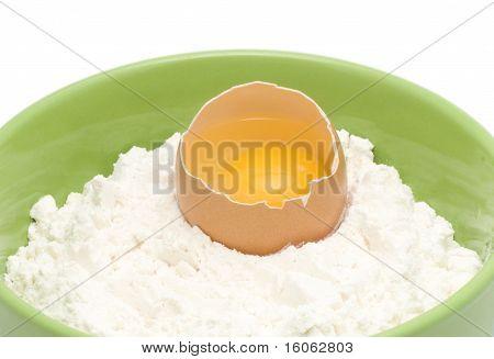 An egg is in a flour