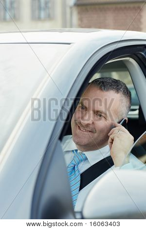 Businessman In Car Talking On Mobile Phone