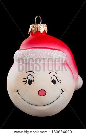Christmas toy smiley face isolated on black background