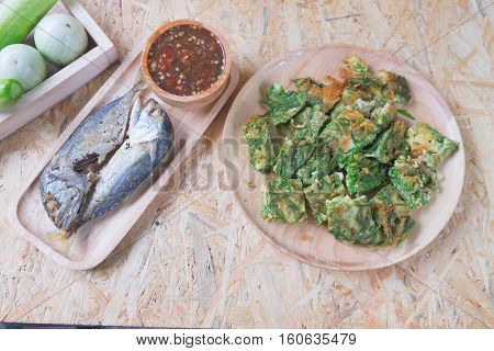 Fried acacia pennata omelet with sauce of shrimp paste and chili (Nam prik kapi) and fried mackerel Thai Cuisine