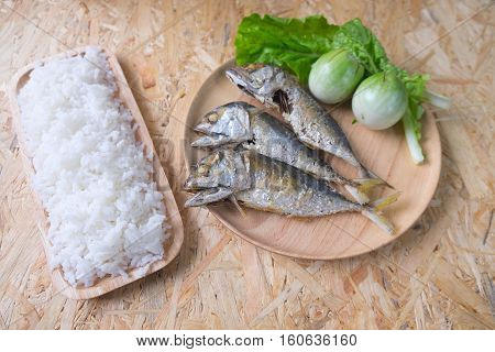 fried mackerel eating with rice and vegetable original Thai food