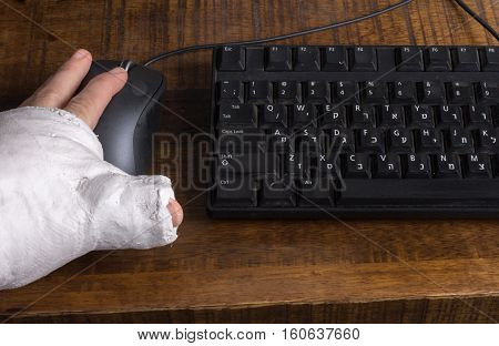 Person With Arm Cast Using A Computer Mouse