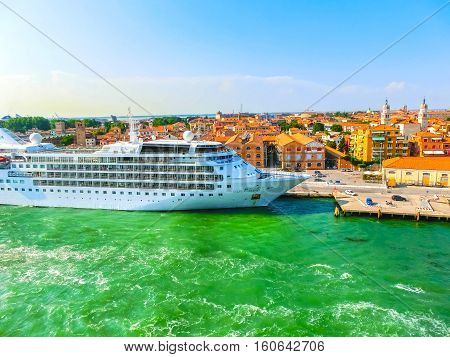 Venice Italy - June 06 2015: Cruise Ship Silver Wind docked at the port of Venice Italy on a background of the roofs on June 06 2015