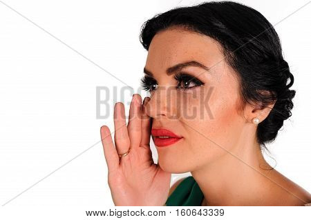 hand gesture of woman with freckles telling secrets, isolated on white