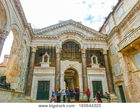 Split Croatia - May 08 2014: Tourists walking in the Old City on a cloudy summer day on May 08 2014 in Split Croatia.